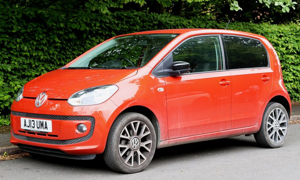 a red Volkswagen Up car