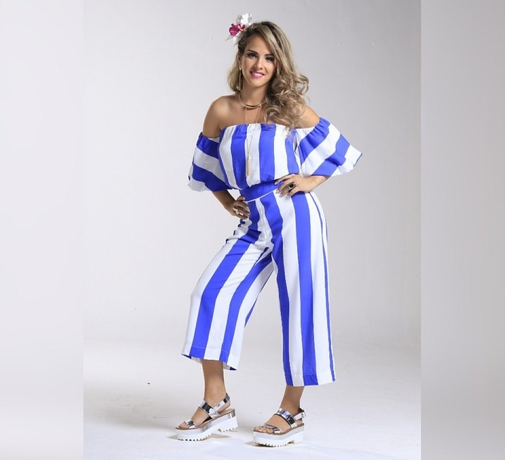A woman wearing a striped blue and white jumpsuit