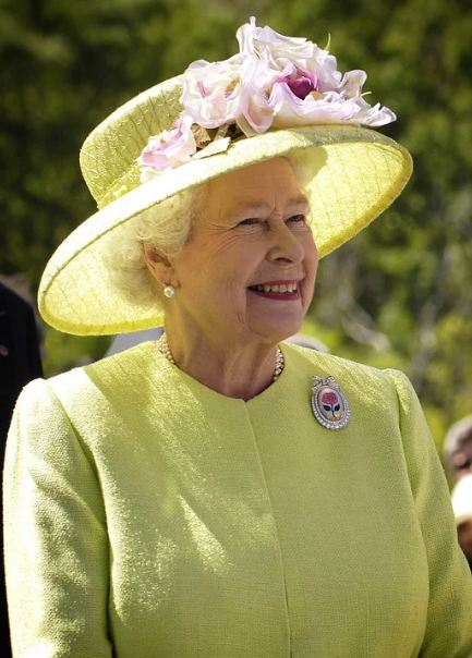 Queen Elizabeth wearing a yellow dress and a yellow hat